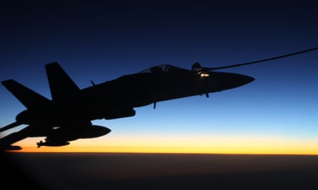 An F/A-18A Hornet from Australia's Air Task Group refuels at sunset from a Royal Australian Air Force KC-30A Multi Role Tanker Transport aircraft during the first mission of Operation OKRA to be flown over Syria