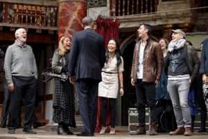The US president Barack Obama jokes with performers after watching a selection of songs and excerpts from Hamlet during his visit to the Globe theatre in London