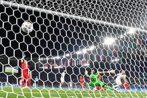 Italy's forward Ciro Immobile (right) scores a goal.