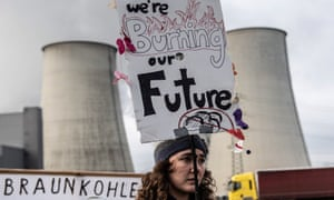 A climate activist protests outside a fossil fuel plant in Jänschwalde, Germany.