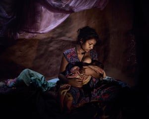Saraswati, 16, must live in a closed dark room with her three day old baby because she bled after childbirth