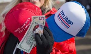 A vendor sells merchandise outside a rally for Republican presidential candidate Donald Trump at the airport in Dubuque, Iowa.