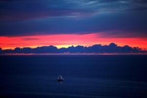 Fortaleza, Brazil A boat sails at sunset