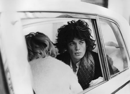 Mick Jagger shooting the final scenes in a white Rolls-Royce borrowed from John Lennon.