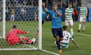 Aleksandr Kokorin celebrates scoring his side's third goal in Zenit's emphatic victory against Celtic in the Europa League round of 32 second leg in St Petersburg.
