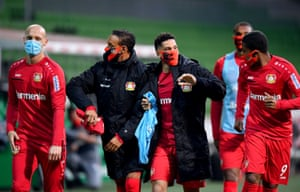 Leverkusen players leave the field at half-time.