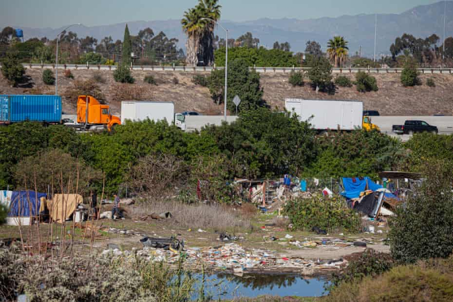 Homeless camp along the Los Angeles river. Anti-homeless laws in some cities force people into shelters.