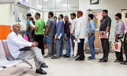 People queue for driving licences in New Delhi.