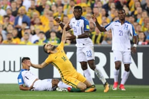 Aziz Behich is one of a number of Socceroos to be scythed down in the first half as the visitors get physical.