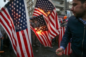 Iranians burn US flags in Tehran during a ceremony to mark the 40th anniversary of the Islamic revolution