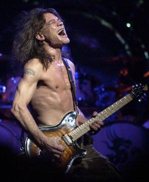 Van Halen guitarist Eddie Van Halen performs Thursday, Aug. 5, 2004, at America West Arena in Phoenix.