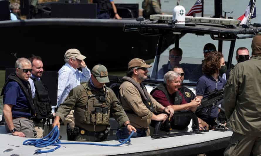 Ted Cruz, center, a Texas senator, and Lindsey Graham, right, a senator from South Carolina, tour a section of the US-Mexico border.