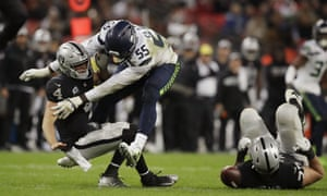 Oakland Raiders quarterback Derek Carr (4) is sacked by Seattle Seahawks defensive end Frank Clark (55) during the second half at Wembley.