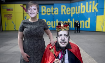 Protesters with masks of German chancellor Angela Merkel and Recep Tayyip Erdogan, president demonstrate against the prosecution of comedian Jan Böhmermann for singing an 'insulting song'.