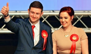 Jim McMahon with his partner Charlene celebrates victory at the Oldham West and Royton constituency by-election count.