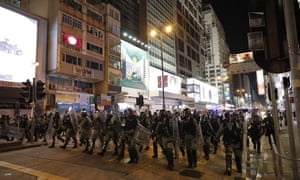 Riot police in Hong Kong on Friday.