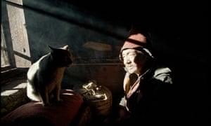 Monk and his cat in Bhutan