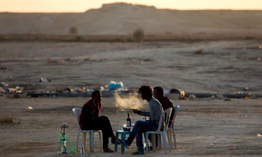 A group of Eritrean men outside Holot detention centre in the Negev desert.