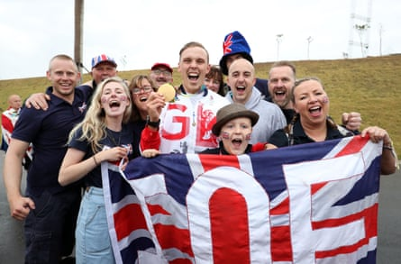 Great Britain's Joe Clarke celebrates gold with his girlfriend, family and friends.