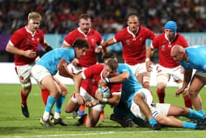 Elliot Dee of Wales is held up at the try line by Alejandro Nieto of Uruguay.