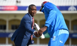 Michael Holding shakes hands with the West Indies captain Jason Holder
