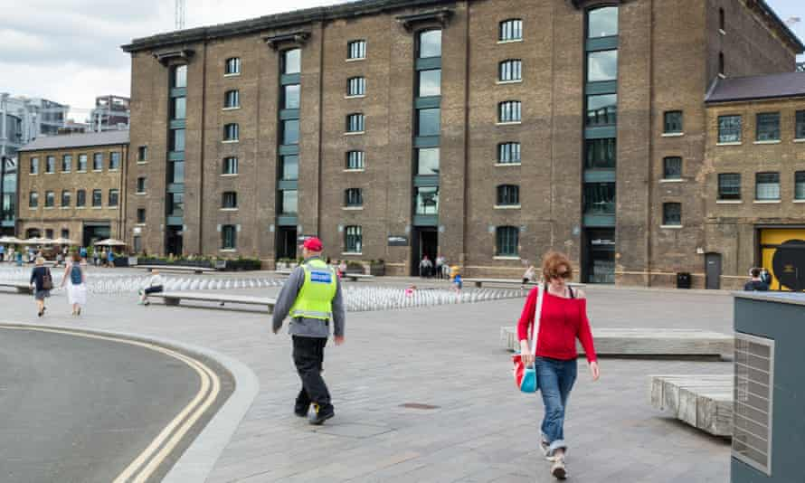 A security guard in Granary Square in King's Cross, London, which is another pseudo-public space