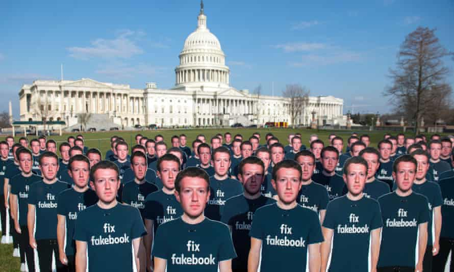 protesters' cardboard cutouts of Mark Zuckerberg outside the US Capitol