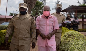 """Hotel Rwanda"" hero Paul Rusesabagina, in the pink inmate's uniform, arriving at Nyarugenge court in Kigali."