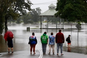 Residents watch floodwaters submerge streets at Raymond Terrace, north of Newcastle