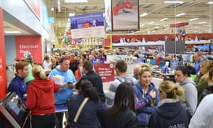Black Friday shoppers overwhelm a Tesco store in 2014.