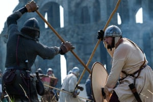 Whitby, UK: Re-enactors depict a skirmish between Viking warriors and Northumbrians during the Viking Festival at Whitby Abbey in North Yorkshire