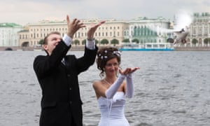 'Off you go and, er, best of luck' … a couple celebrate their wedding by releasing doves.