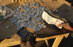 Harare, Zimbabwe: With inflation soaring and cash in short supply, many Zimbabweans seek out street moneychangers, paying a premium for hard cash
