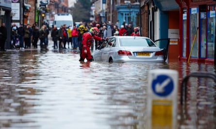 Waterside rescuers on the flooded Walmgate in York city centre a year ago.