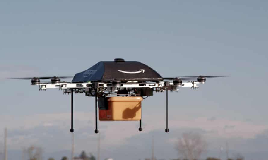 Amazon shows off an 'octocopter' mini-drone that would be used to fly small packages to consumers on a test flight in 2013.