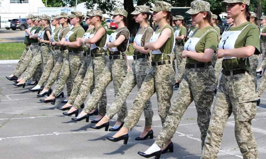 A handout photograph taken and released by the Ukrainian Defence ministry press-service on July 2, 2021 shows the Ukrainian female soldiers wearing heels while taking part in the the military parade rehearsal in Kiev.
