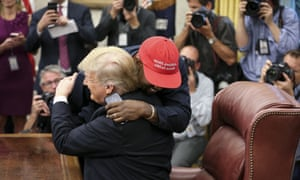 Donald Trump hosts Kanye West in the Oval office of the White House on 11 October.