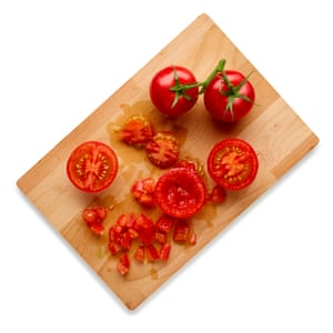 Cut the tomatoes in half, scoop out and discard the watery seeds, then finely chop the flesh.