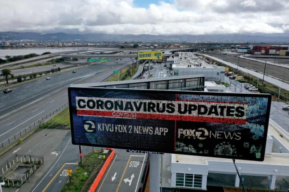 A billboard in Oakland, California, advertises a local news station's app that provides updates on the coronavirus.