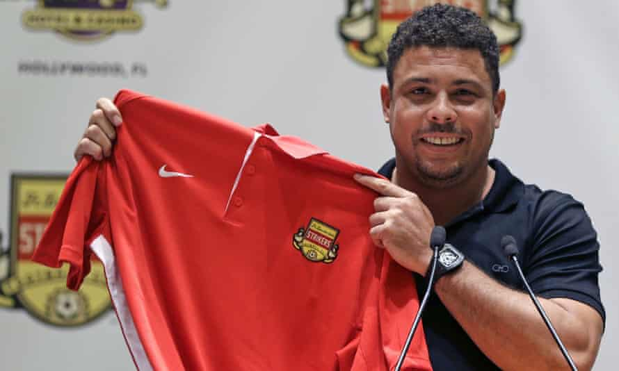 Ronaldo holds a Fort Lauderdale Strikers jersey after an event to promote his position as a part-owner