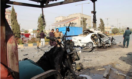Afghan security officials inspect the scene of the explosion that killed Elyas Dayee in Lashkar Gah, the provincial capital of Helmand, on 12 November.