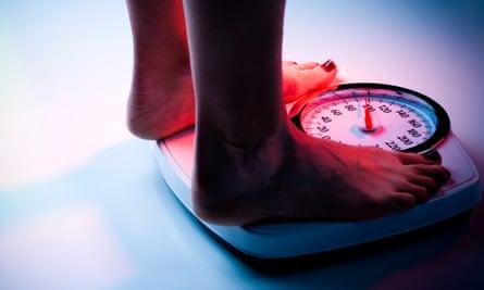 Woman's feet on bathroom scales