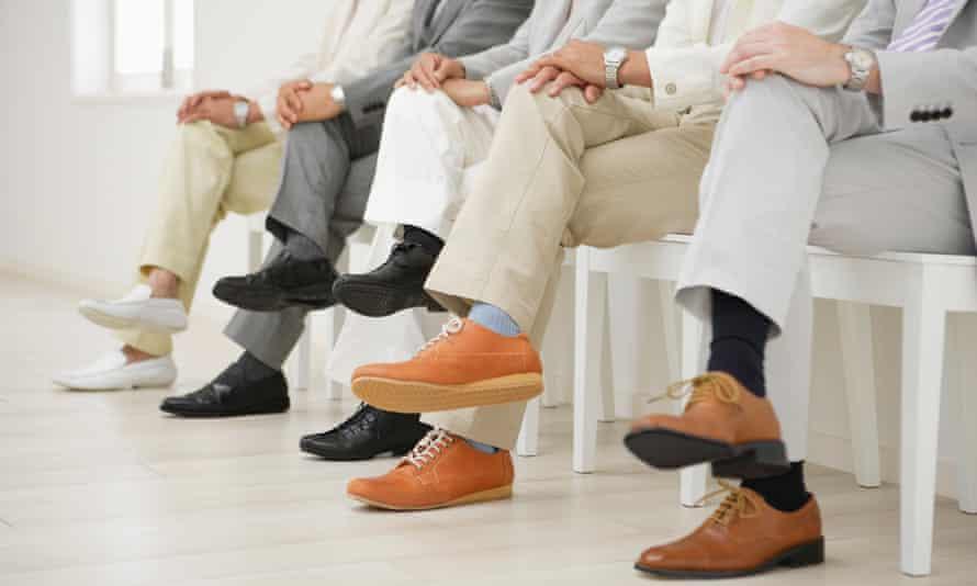 Businessmen sitting in a row.