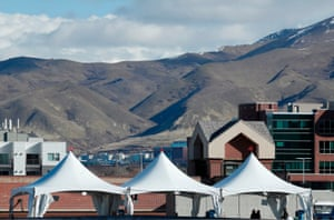 Three tents are set up for a testing facility in a parking lot outside the University of Utah's Sugar House health clinic in Salt Lake City.