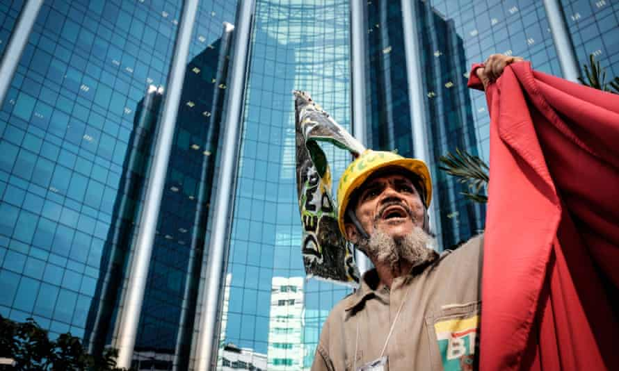 A worker of Brazilian oil company Petrobras takes part in a protest.
