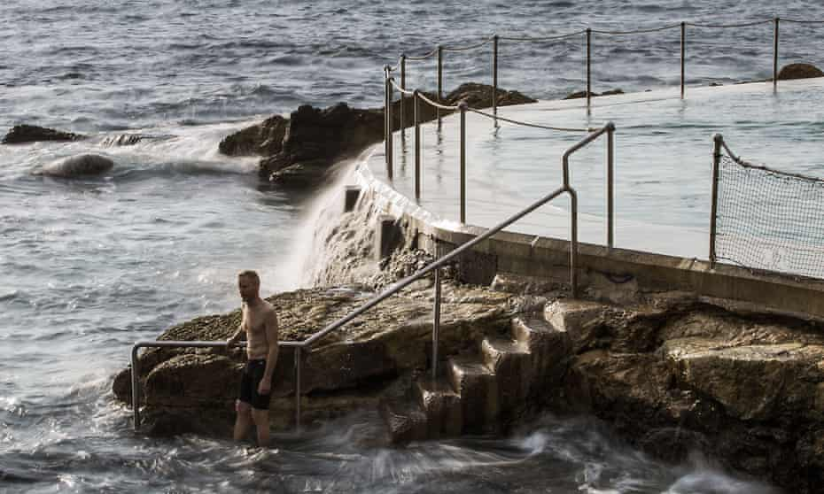 A swimmer enters the sea