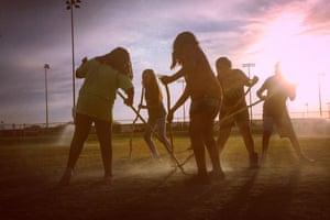 Schoolgirls from the Salt River Pima-Maricopa Indian Community in Arizona play toka