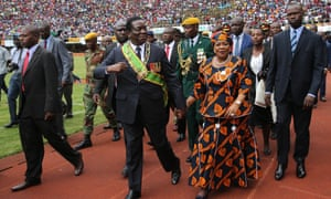 Zimbabwean President Emmerson Mnangagwa (C, front) and his wife Auxillia (R, front) attend a celebration marking the nation's 38th independence anniversary
