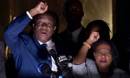 Emmerson Mnangagwa, with his wife, Auxillia, speaks at the Zanu-PF headquarters in Harare on Wednesday.