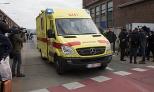 Ambulances move in as passengers and airport staff are evacuated from the terminal building after explosions at Brussels Airport in Zaventem